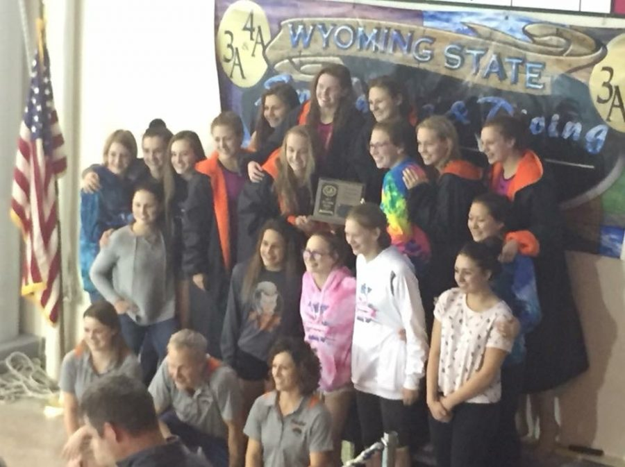 The+PHS+girls%27+swimming+and+diving+team+poses+on+the+podium+after+placing+third+at+the+state+meet+in+Gillette+on+Friday.