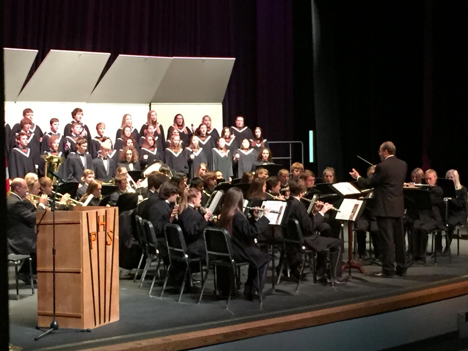 Choral Director Mr. John Miller conducts Powell High School's choirs and band during the Veteran's Day assembly Nov. 9.