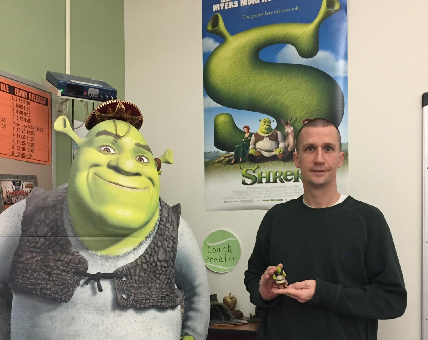 Mr. Brandon Preator poses in his classroom with several of his Shrek possessions.