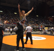 Coach Nate Urbach lifts Brody Karhu after Karhu won the state wrestling title.