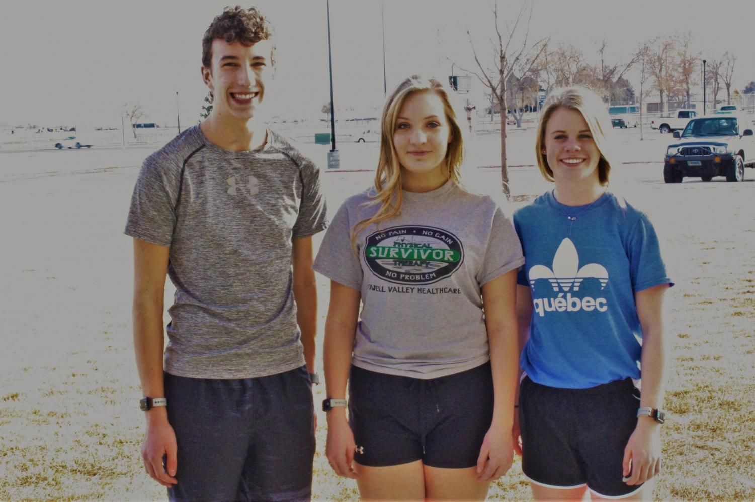 """PHS freshmen (from left) Ben Whitlock, Whitney Jones and Jenna Hillman pose in their shorts and T-shirts on a """"warm"""" winter's day."""