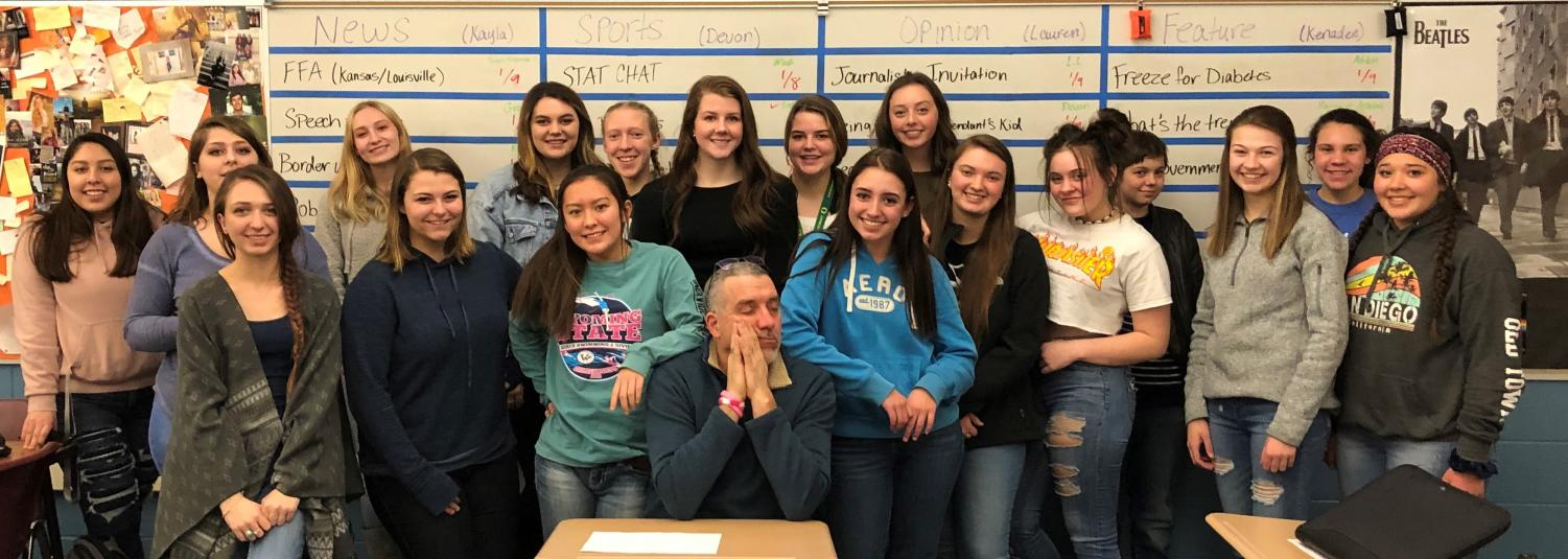 Prowl adviser Mr. Vin Cappiello is flanked by the female members of the Prowl staff. Since this photo was taken, two males have joined the formerly all-female staff.