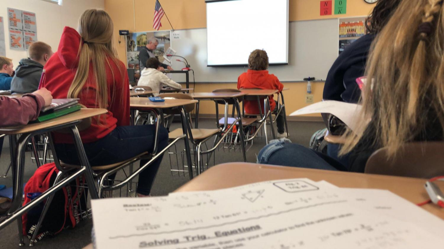 Trigonometry students listen to Mr. Greg Stenlund's lesson recently.