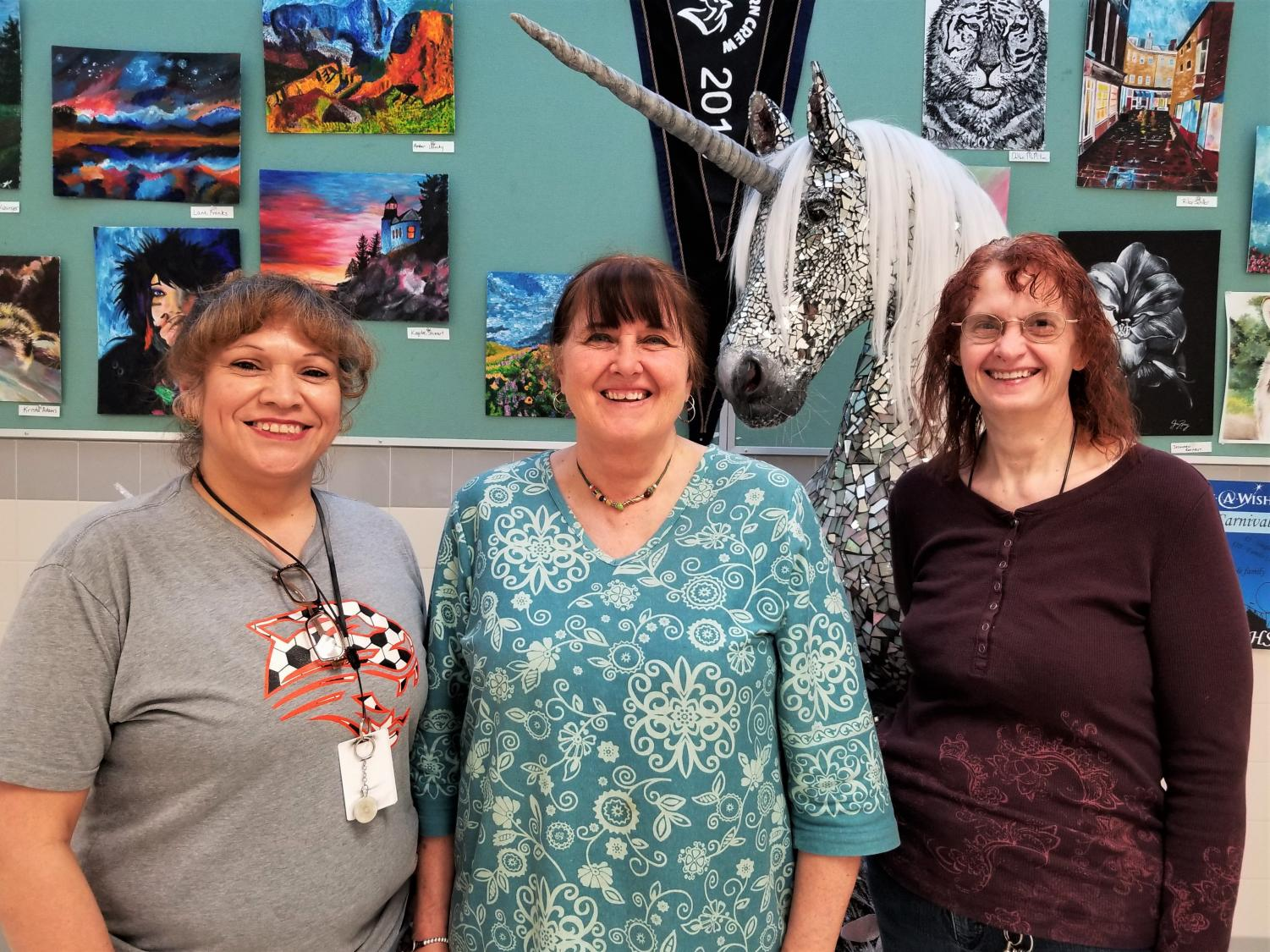 (From left) Delia Carbajal, Linda Tilley, and Jan Castro pose for a picture. They serve as Powell High School's evening custodial staff.