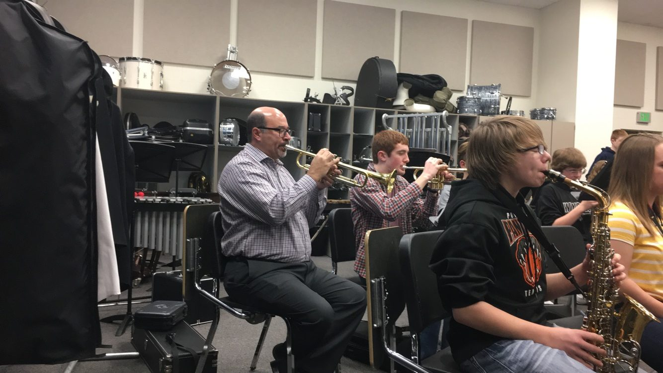 Fabela plays his trumpet along with the PHS band during class.