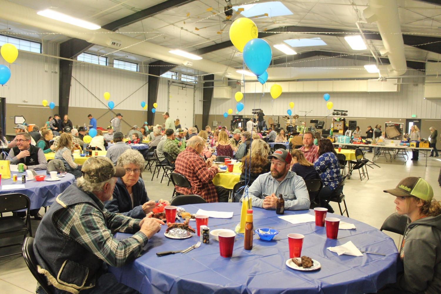 FFA Dinner Dance goers converse and eat at the Park County Fairgrounds.