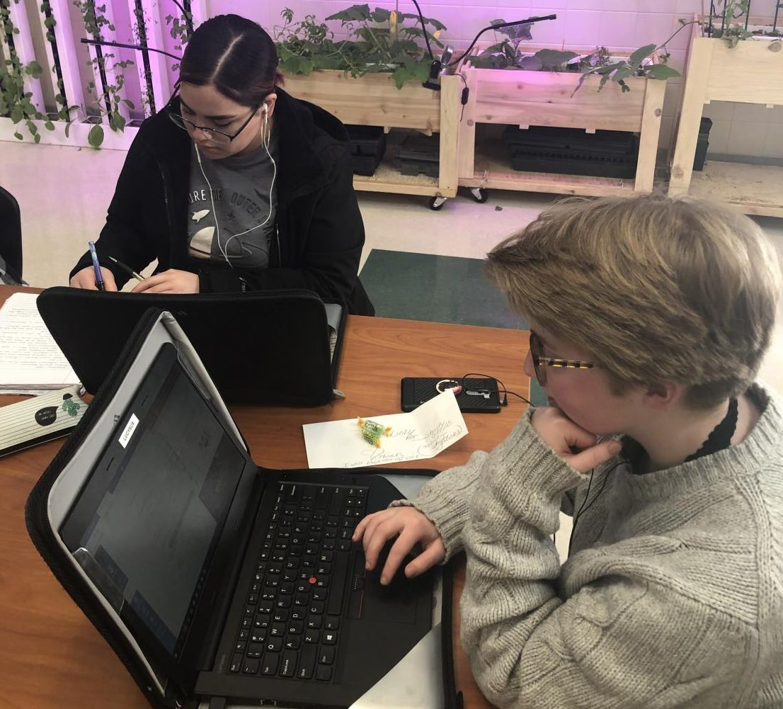 Ariana Rodriguez (left) and Lucy Sullivan work diligently on their college classes. April 22-26 is PHS spring break which gives students a chance to catch up on college classes.