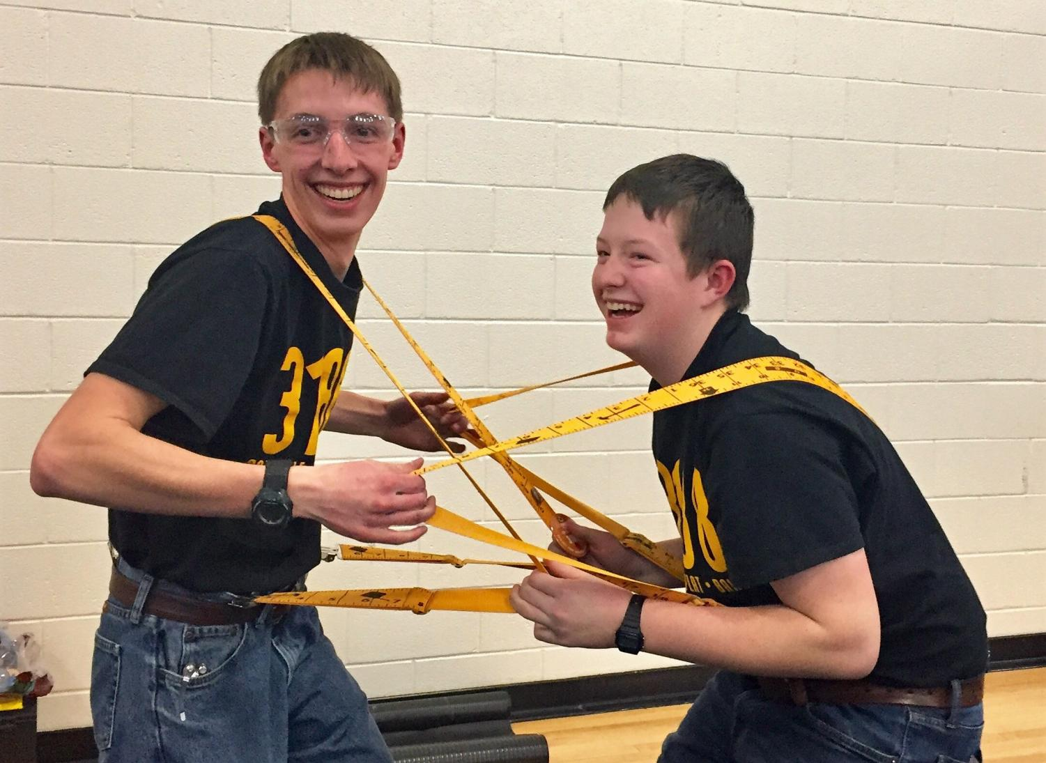 Alan Merritt (left) and Caden Sherman prepare to snap each others suspenders during the state competition in Casper.