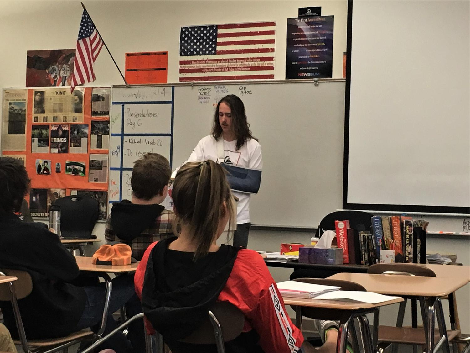 Senior Trent Dicks presents his lyrical analysis speech and video to Mr. Vin Cappiello's first period English For College 2 class.
