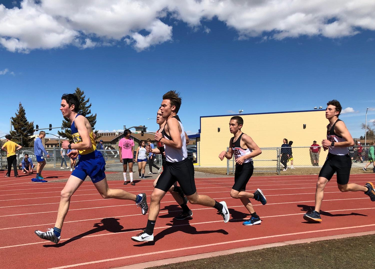 Freshmen distance runners Jace Bohlman, Riley Schiller and Ben Whitlock compete in the opening track meet of the spring in Cody on March 23.