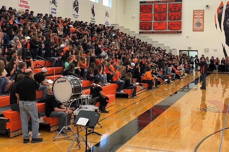 Principal Mr. Jim Kuhn addresses students during the 2018 Homecoming assembly, one of many popular high school events.