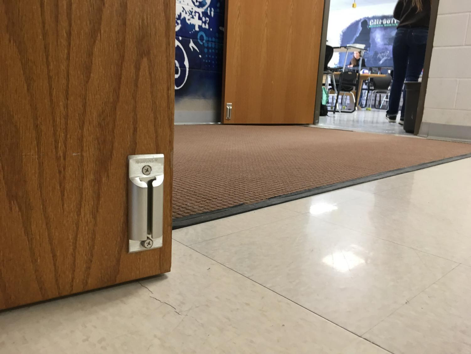 Mr. Vin Cappiello's classroom door, along with all of the doors at the Powell High School, now have a door stopper, a new lockdown feature.