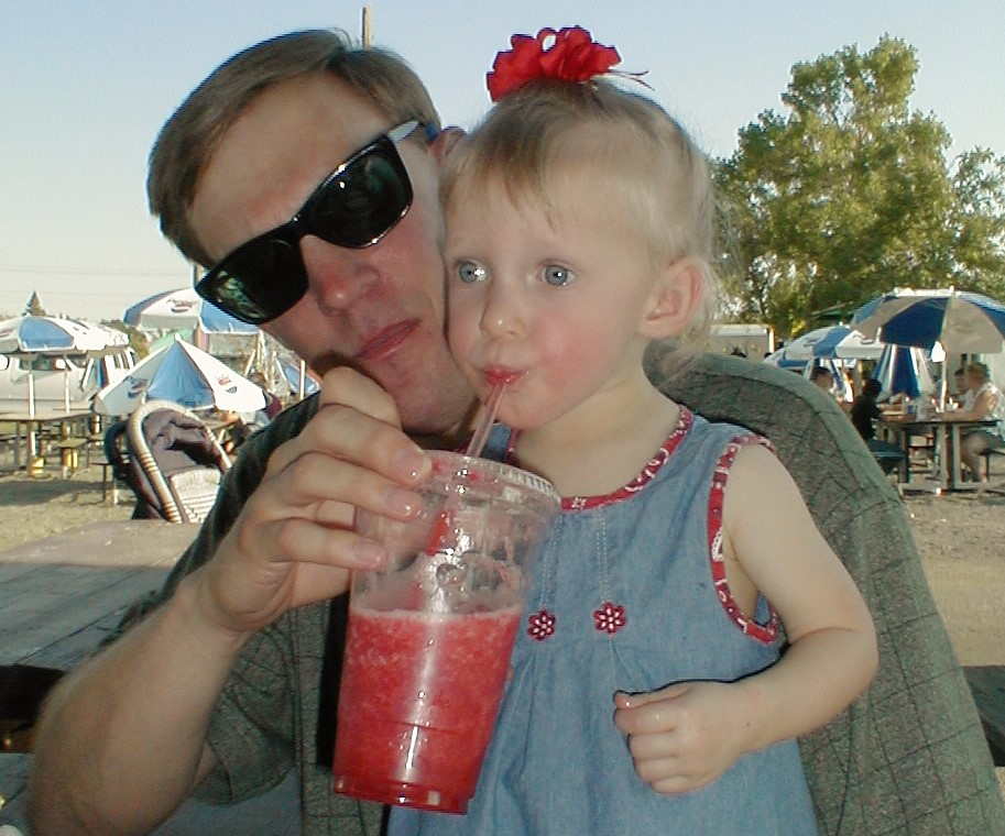 Young Kayla Kolpitcke drinks a strawberry smoothie at the Park County Fair. For many years, it was the only thing she was able to drink or eat at fair because of her allergies.