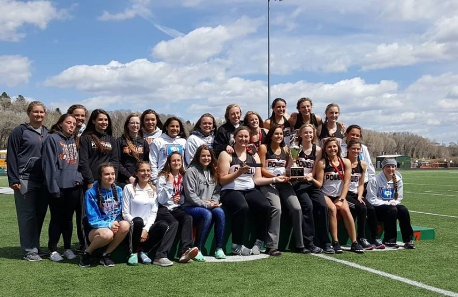 The+Lady+Panther+track+and+field+team+poses+on+the+podium+after+being+crowned+the+3A+West+Regional+Champions.