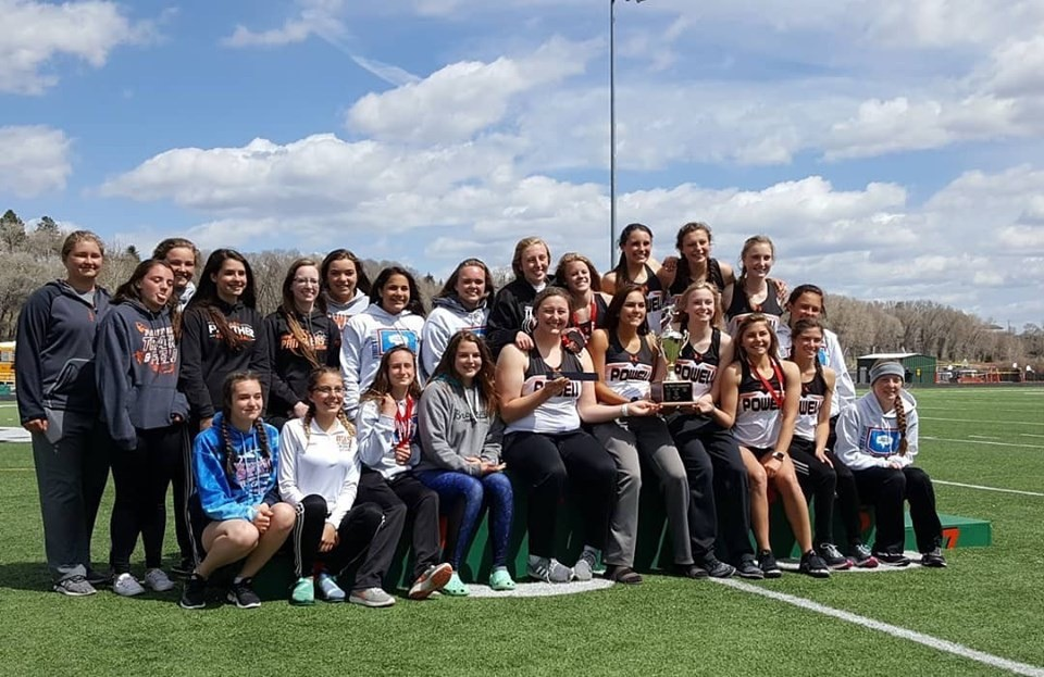 The Lady Panther track and field team poses on the podium after being crowned the 3A West Regional Champions.