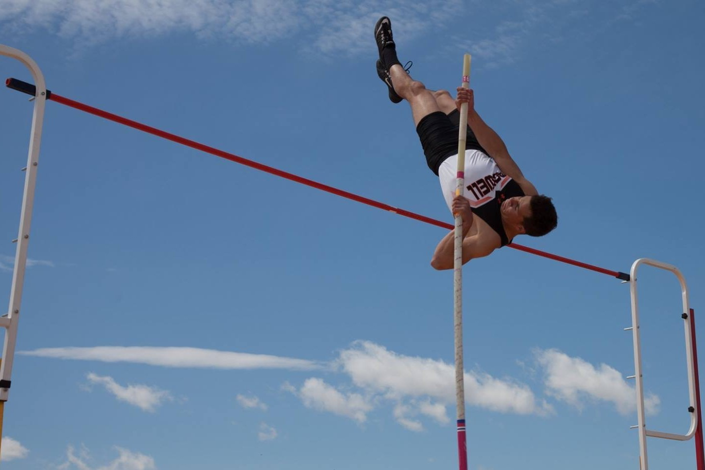 Junior Brody Karhu sets the PHS boys' pole vault record at 15 feet, 1 inch, during the meet in Cowley on April 27.