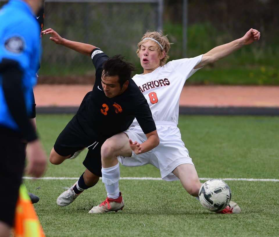 Junior Ernie Acevedo trips while a Worland Warrior attempts to pass the ball in the 3A State Championship game in Jackson. The Panthers placed second after they fell to the Warriors 2-0 May 18.