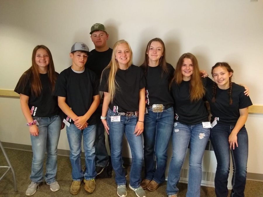 (From left to right) Amber Visocky, Hadley Mehling, Logan Mehling, Rylee White, Madi Harvey, Tegan Lovelady and Amber Visocky stand together during the Casper College Livestock Judging Camp that took place during the summer of 2019.