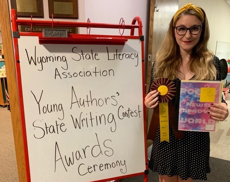 Bailey+Phillips+poses+with+her+prize+after+winning+the+Young+Authors+contest+with+a+collection+of+poems.%C2%A0