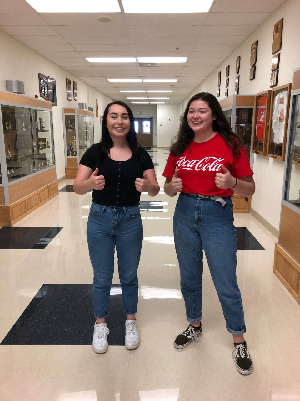 (From left to right) Tenna Desjarlais and Emma Bucher wearing mom jeans.
