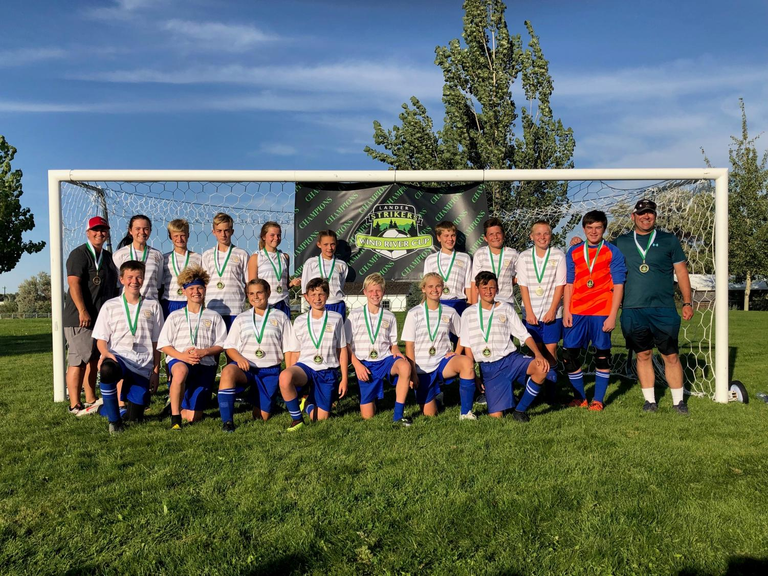 The U16 Heart Mountain Soccer team pose for a picture with their medals after winning a soccer tournament in Lander.