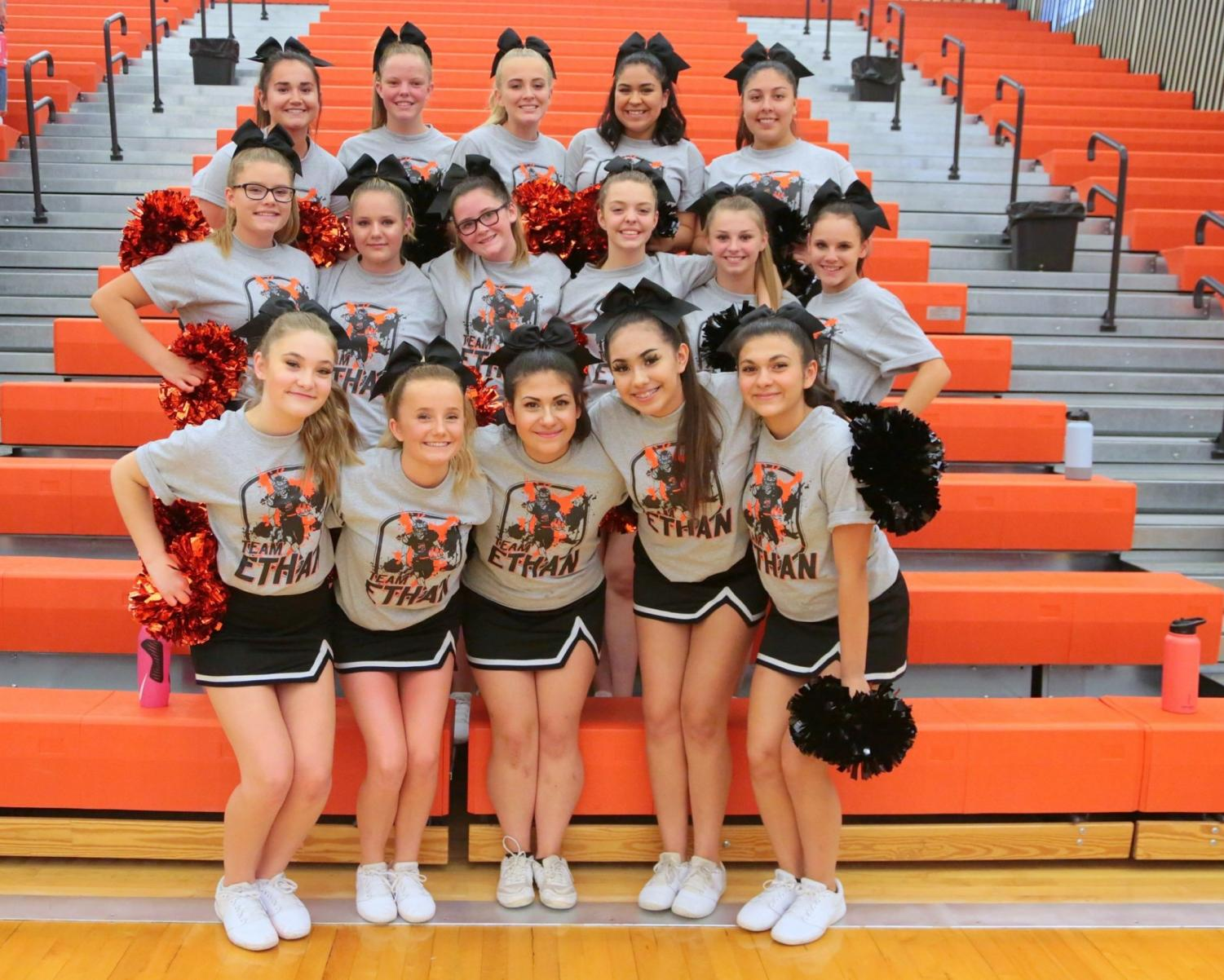 Powell High School cheerleaders cheer on the Lady Panthers volleyball team during their game against the Thermopolis Bobcats on Sep. 12.
