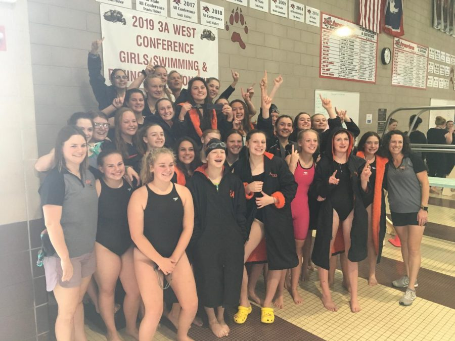 The+Powell+High+School+Lady+Panther+swim+team+stands+and+poses+for+a+picture+after+their+win.