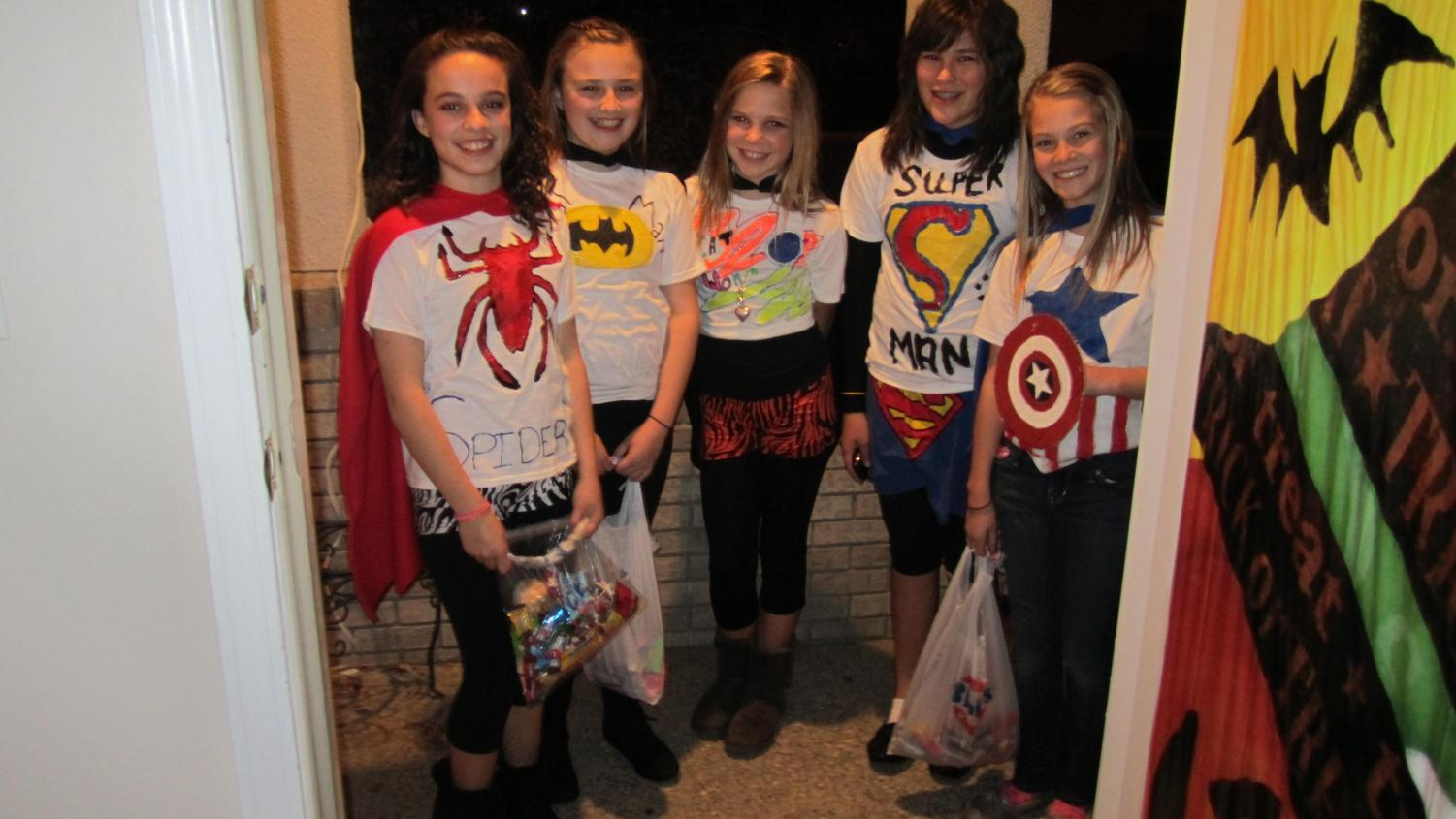 Powell Middle School students (from left) Karlie McKenzie, Katie McKenzie, Addy Howard, Jasmyne Lensegrav and Aubrey Stenerson take a brief picture break in between houses (circa. 2012)