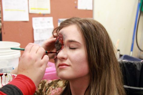 "Fake blood is added around senior Kaitlyn Church's eye ""wound""."