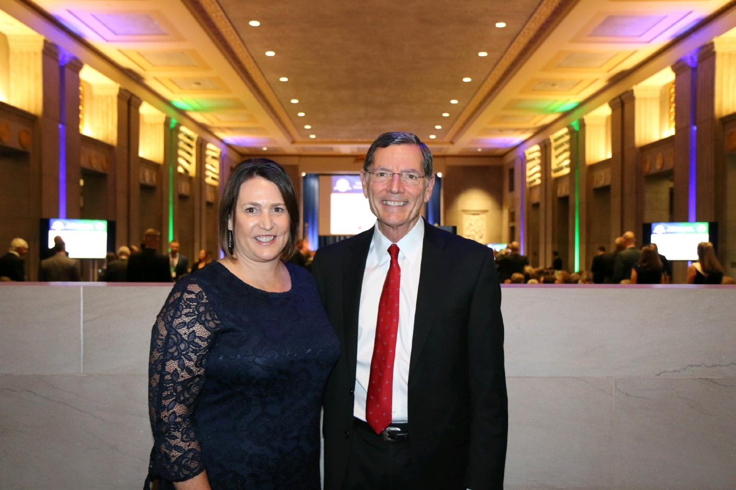 Mrs. Necole Hanks poses with Senator John Barrasso after winning the Presidential Awards for Excellence in Mathematics and Science Teaching.