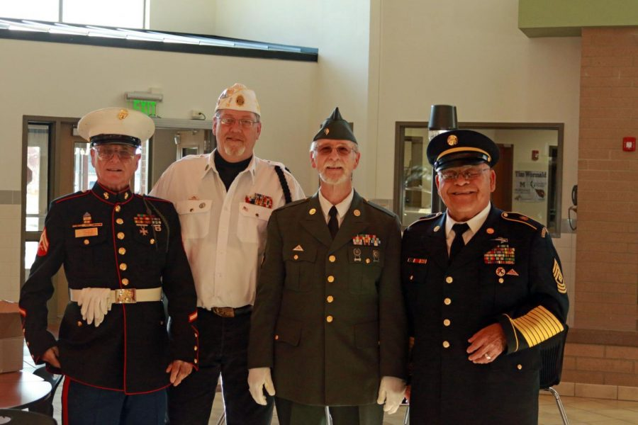 Veteran attendees of Powell High School's Veteran's Day Program pose in the PHS commons Nov. 11.