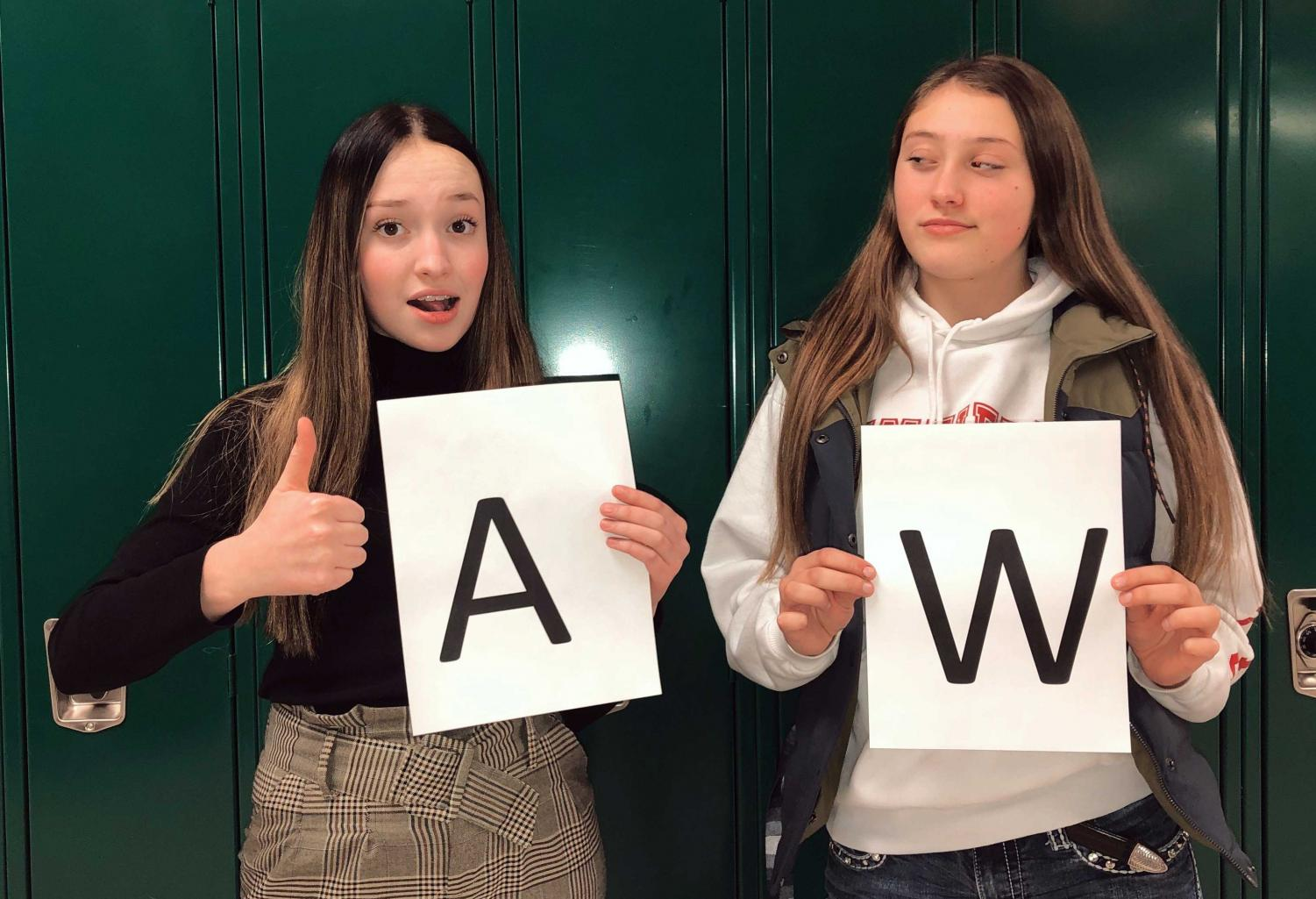 Prowl reporters (from left) Kalli Ashby and Emerson Wormald pose for a picture representing their feelings toward their first letter of their last name