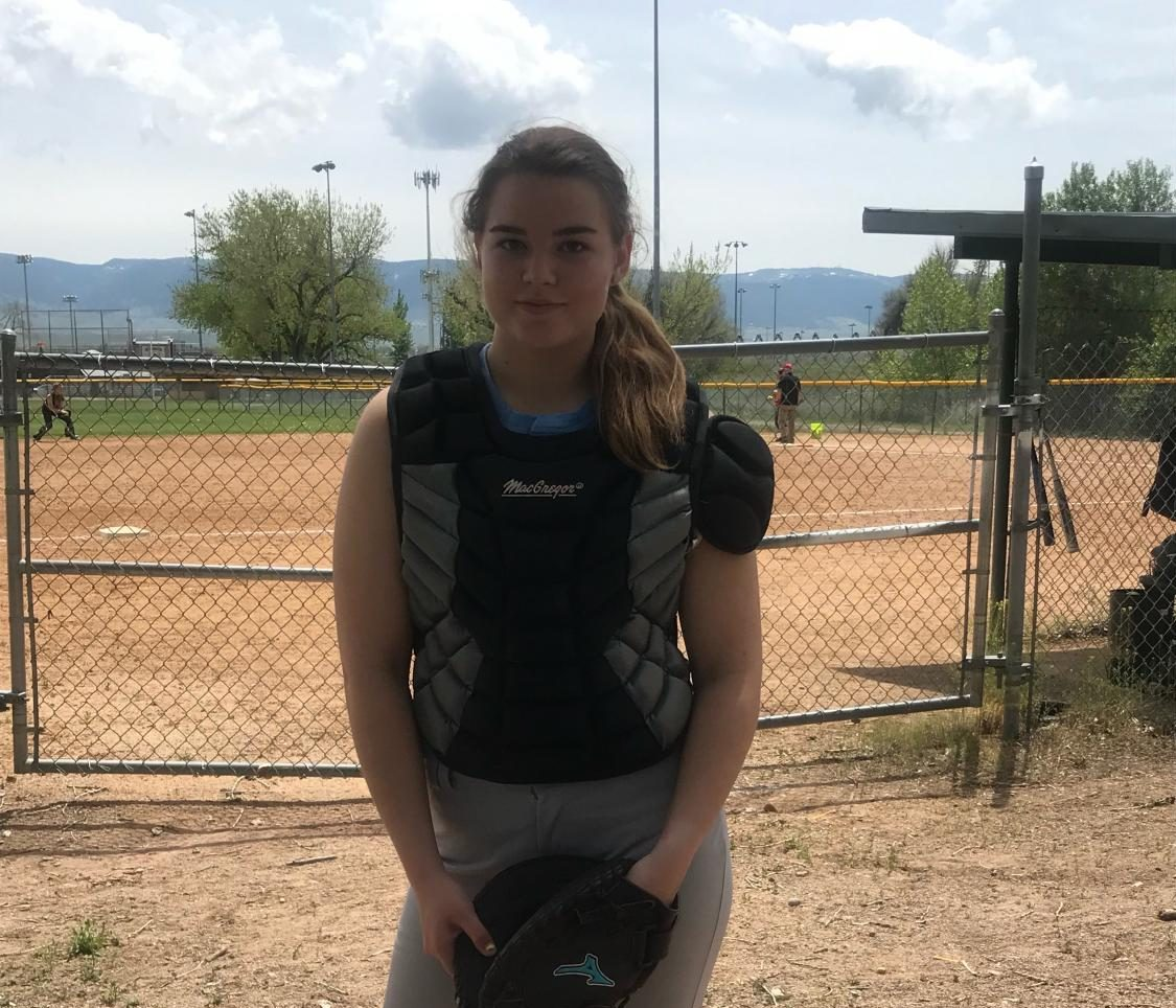 Tegan Lovelady poses in her catching gear at the Casper Softball Complex minutes before the Powell Roughriders stepped on the field to play their first game of the 2019 summer season.