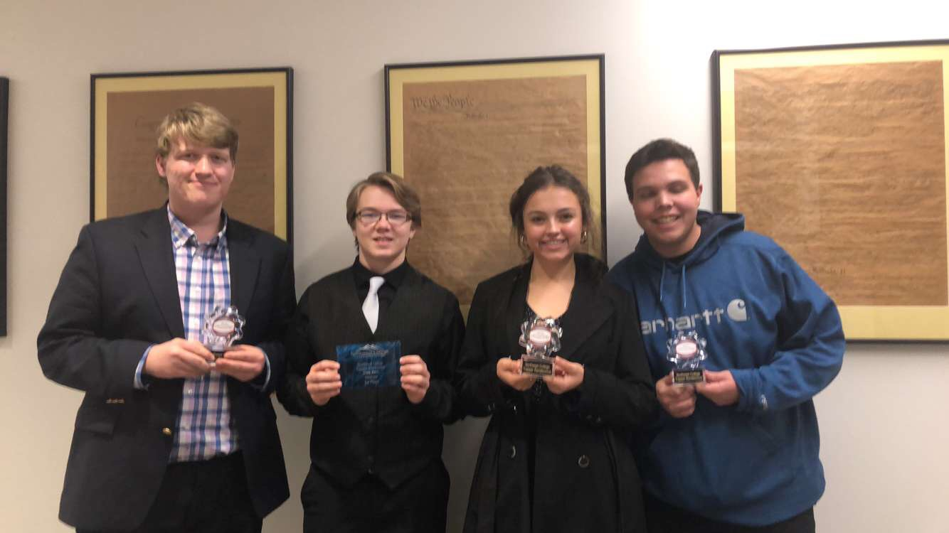 Members+of+the+Powell+High+School+Speech+and+Debate+team+present+their+awards+won+at+the+Northwest+College+Speech+and+Debate+Tournament.+%28From+left%29+Duncan+Bond%2C+Aiden+Chandler%2C+Elise+Spomer+and+Jaxton+Braten.