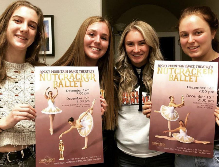 Rocky Mountain Dance Theatre's seniors (from left) Meg Burkhart, Emily Cole, Skylar Cooley and Solie Jackson pose with the posters for the RMDT's production of The Nutcracker.