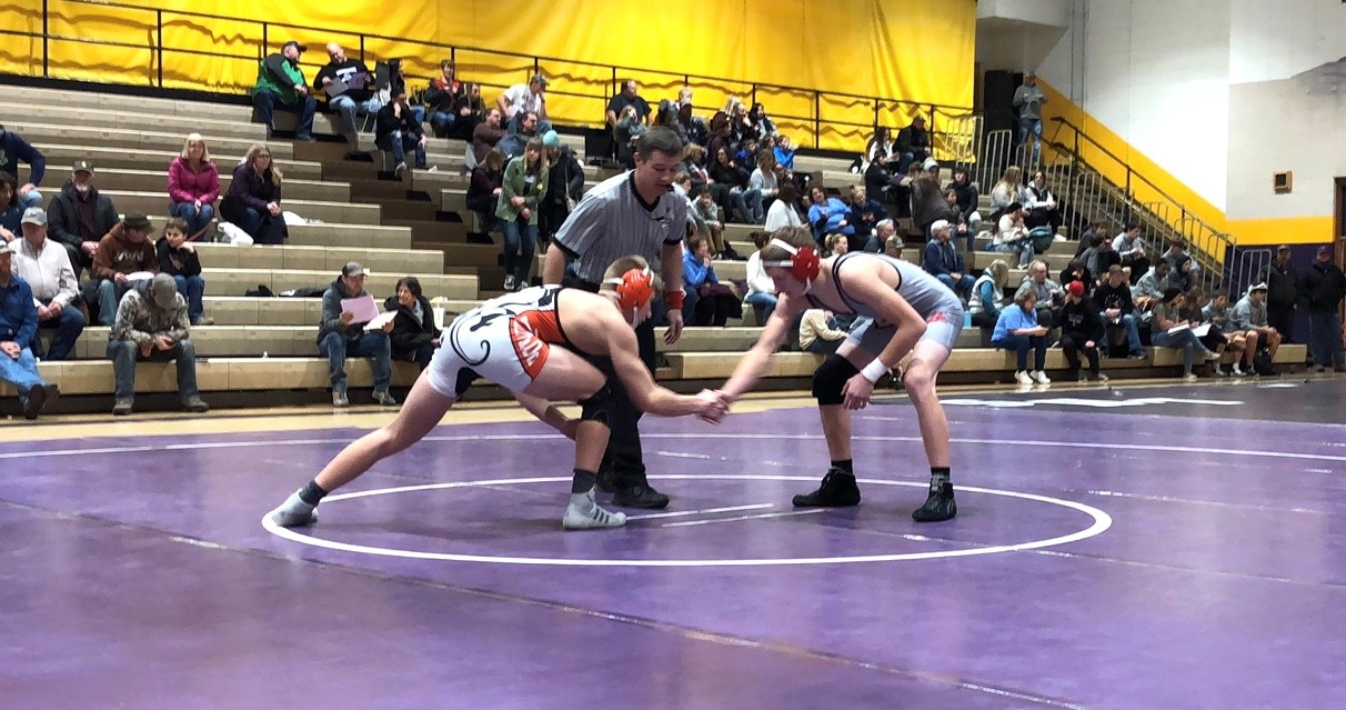 Varsity+145+pound+junior+Riley+Bennett+%28left%29%2C+wrestled+Garrett+Sholley+%28right%29+from+Huntley+Project+at+the+Laurel+Quad+Dual+on+Tuesday.