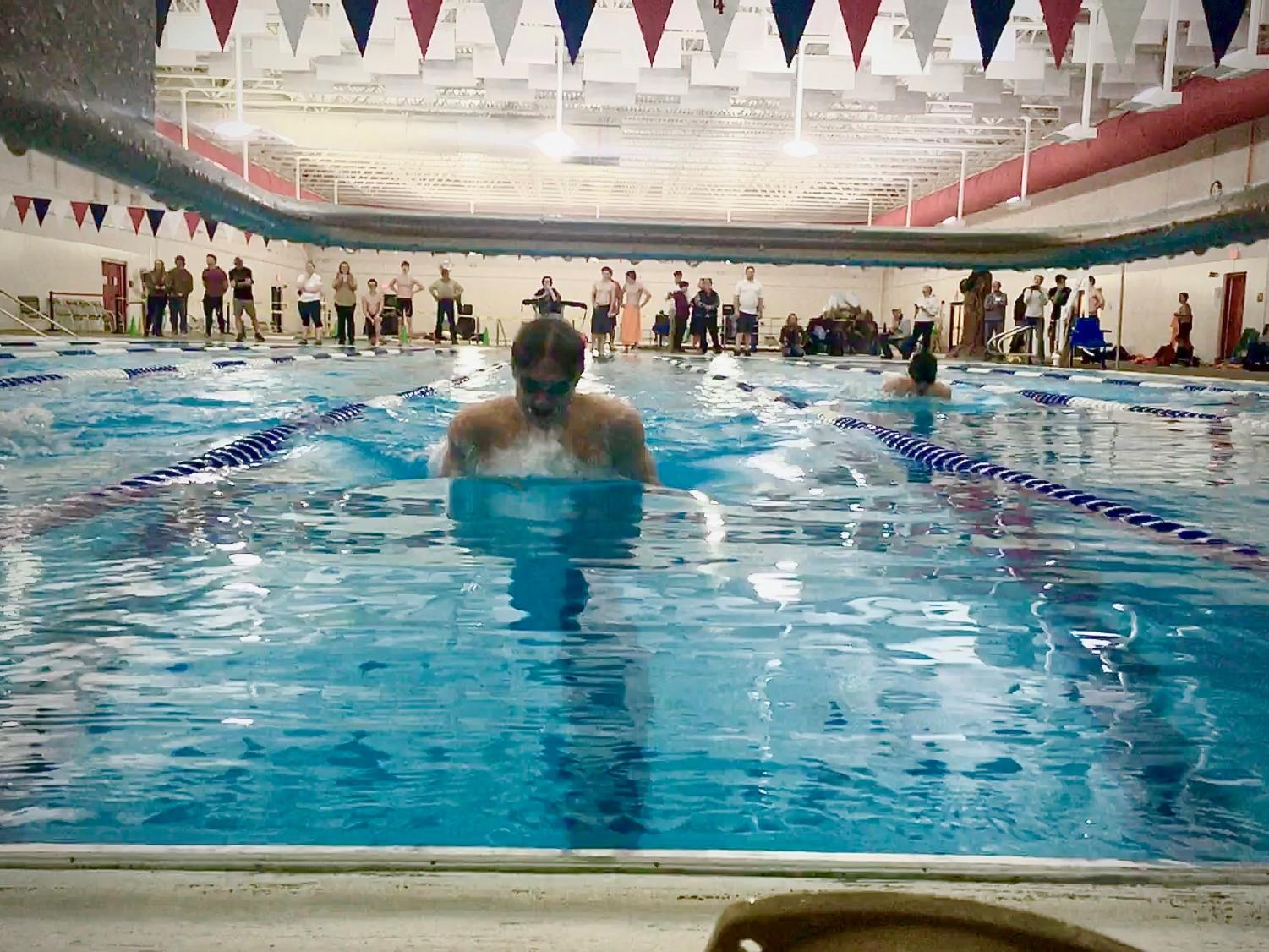 Richard Spann swims his way to first place in the 100-yard breaststroke at the Powell Swim Meet Tuesday, Jan 21.