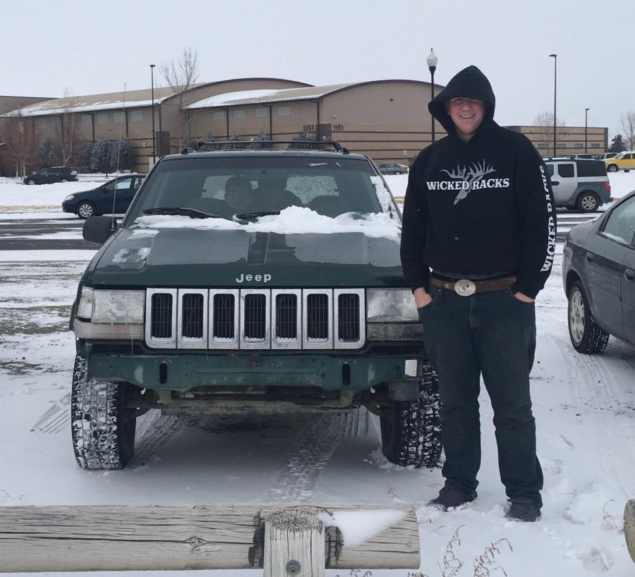Senior Dallas Oliver poses with his crappy car. His vehicle was voted the crappiest car of PHS.