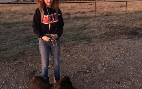 Lucyjane Crimm walking Prez before going to Powell High School.