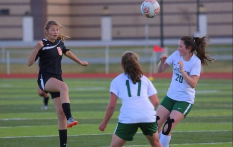 Junior Madi Fields looks to trap the soccer ball when playing the Lander Valley Tigers.