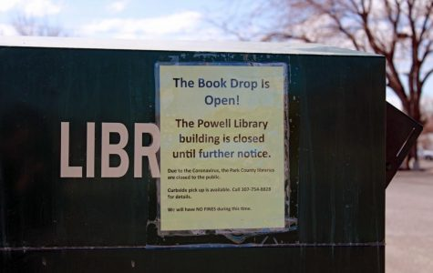 A sign outside the Powell Public Library, attached to the bin where books can be returned, helps patrons use the system