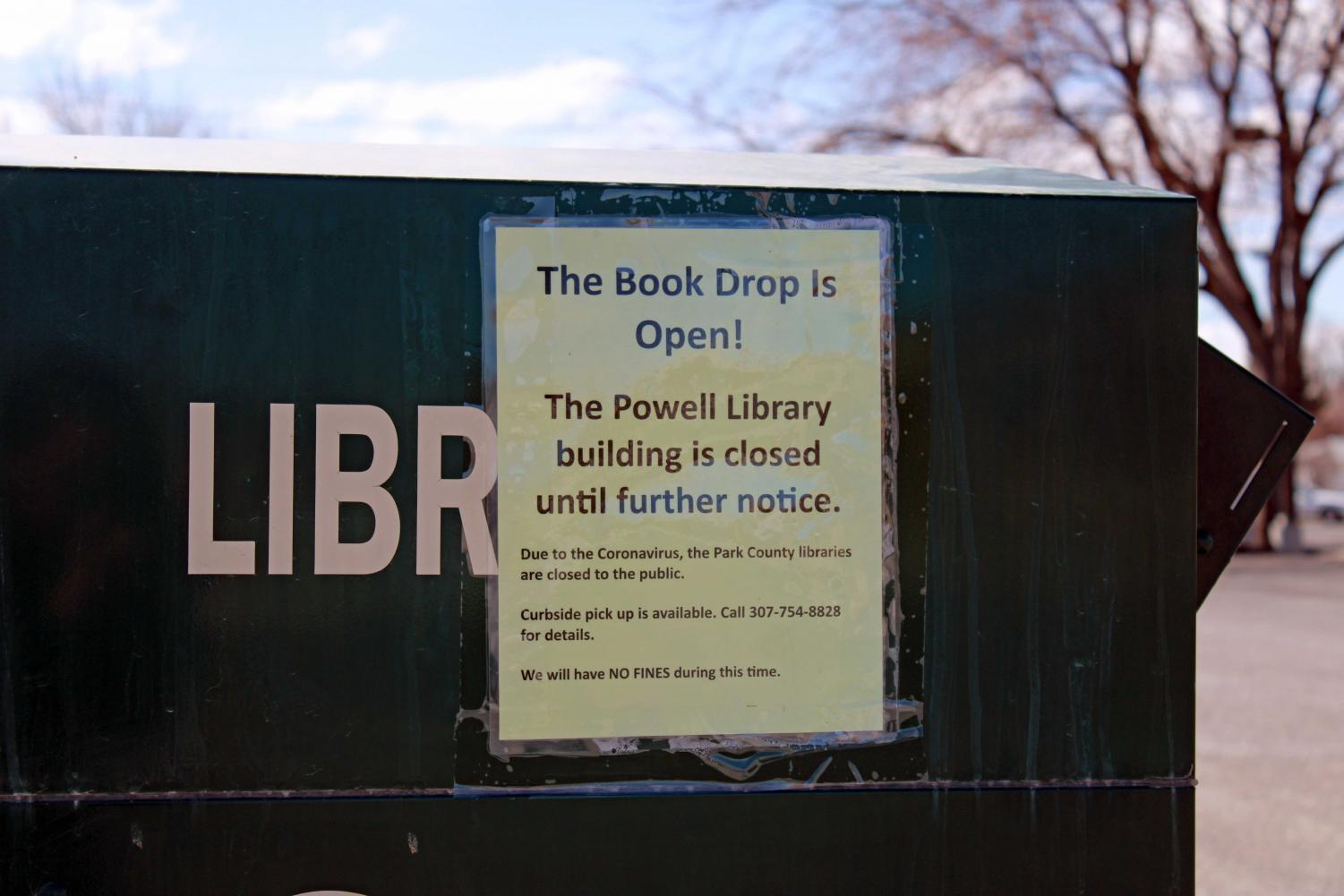 A+sign+outside+the+Powell+Public+Library%2C+attached+to+the+bin+where+books+can+be+returned%2C+helps+patrons+use+the+system