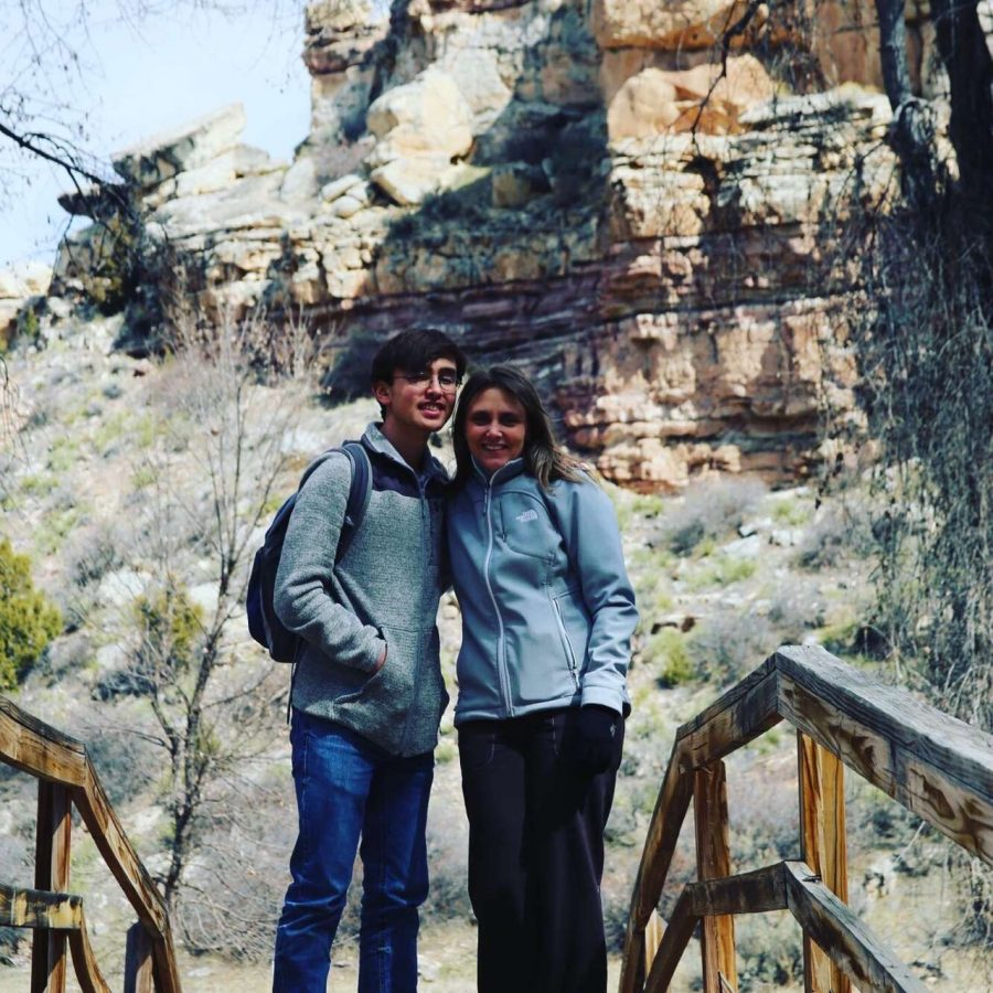 Sophomore Riley Schiller and his mom Kelli Schiller pose while hiking at Medicine Lodge State Archaeological Site.