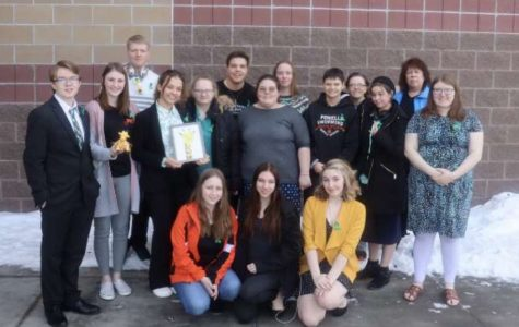 The Powell speech and debate team pose for a group photo before attending the awards assembly at the Riverton tournament.