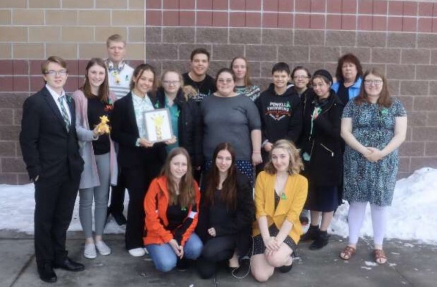 +The+Powell+speech+and+debate+team+pose+for+a+group+photo+before+attending+the+awards+assembly+at+the+Riverton+tournament.+%0A