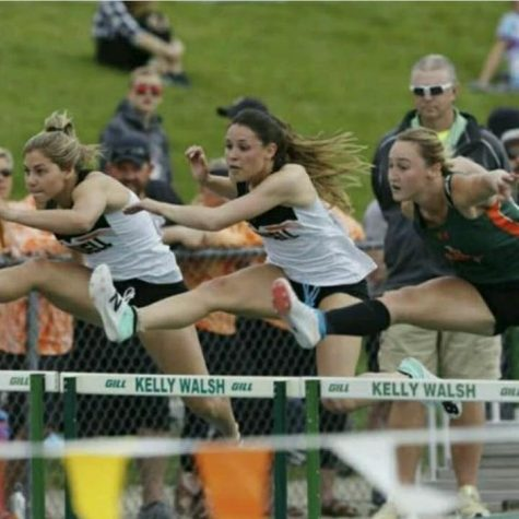 Senior Sabrina Shoopman races against two competitors, including PHS 2019 alum Caitlyn MIner (left), in the 100-meter hurdle competition last spring.