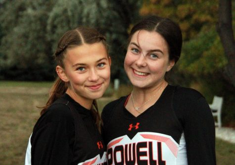 Senior foreign exchange students Greta Artursson and Sanne Flateby pose for a picture at a cross country meet last fall.
