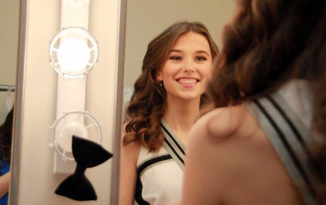 Powell High School senior Greta Artursson poses into the mirror for a photo.