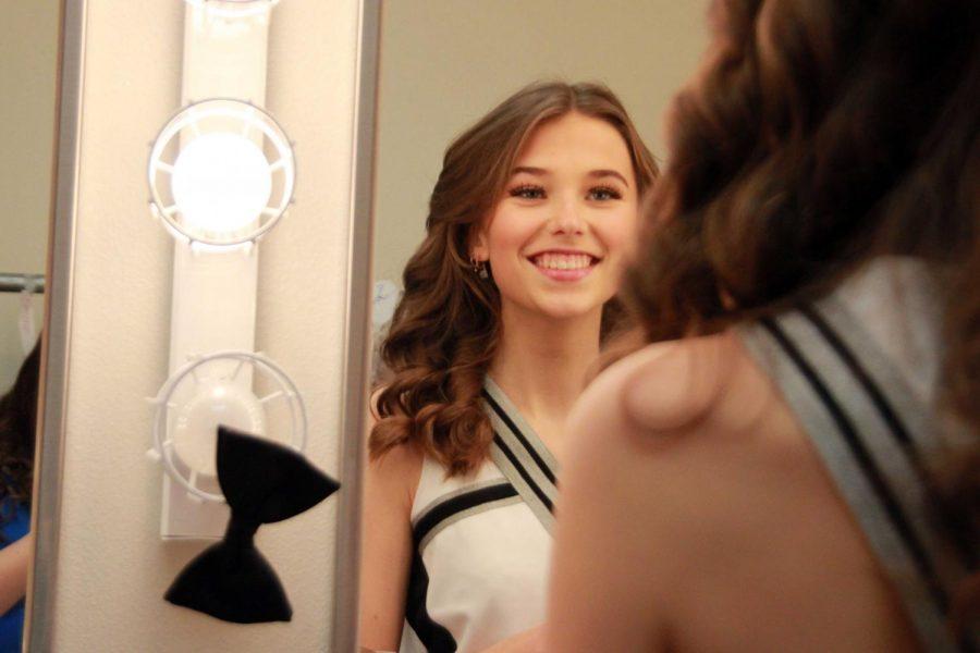 Powell High School senior Greta Artursson poses into the mirror for a photo.
