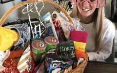 Senior Skylar Cooley poses with the gift basket she received from her newly